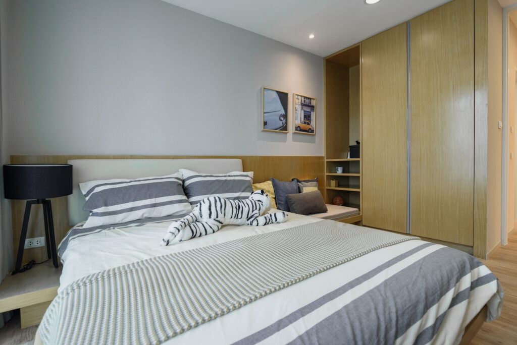 A picture containing bed, indoor, wall, bedroom  Description automatically generated