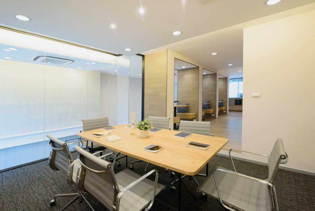 A conference room with a table and chairs  Description automatically generated with low confidence