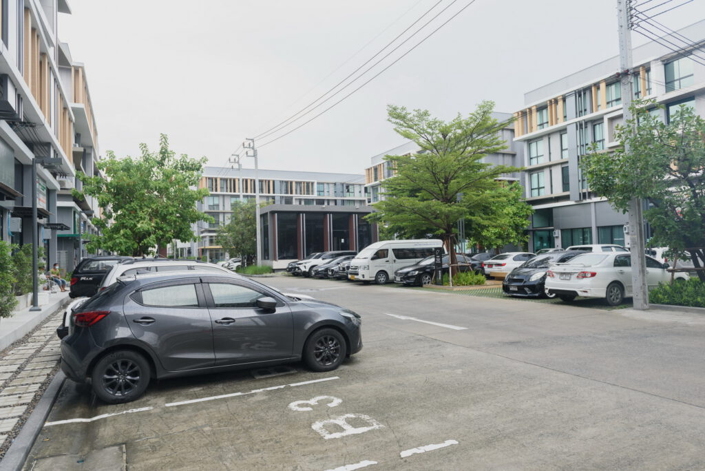 A group of cars parked on the side of a street  Description automatically generated with medium confidence
